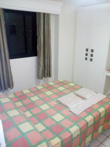 A bed or beds in a room at Boa Viagem Flat