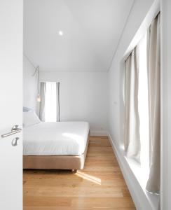 A bed or beds in a room at Lisbon Serviced Apartments - Benformoso