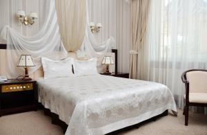Кровать или кровати в номере Отель Софиевский Посад