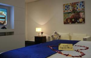 A bed or beds in a room at Le Sphinx Boutique Hôtel