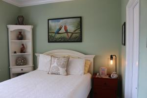 A bed or beds in a room at E5 - On the Pensacola Bay - Welcome to One Love!