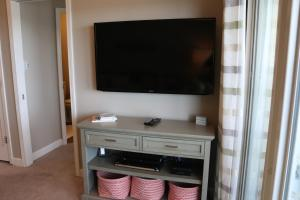 A television and/or entertainment center at E10 - Amazing View from this Upscale Condo