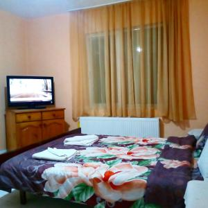 A bed or beds in a room at Guest House Emiliya