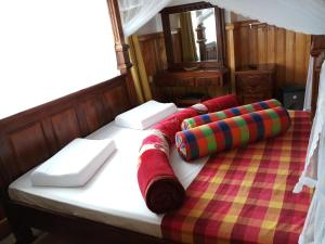 A bed or beds in a room at Highcliffe Guest House