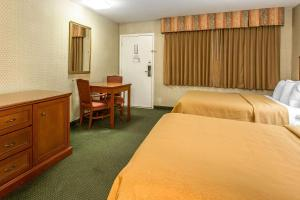 A bed or beds in a room at Quality Inn Near China Lake Naval Station