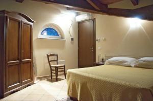 Letto o letti in una camera di Hotel Ristorante La Torretta