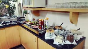 A cozinha ou cozinha compacta de Hotel Maestro Express Toledo
