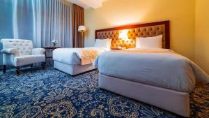 A bed or beds in a room at Ramada by Wyndham Almaty