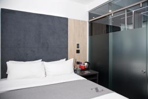 A bed or beds in a room at Z Hotel Bath