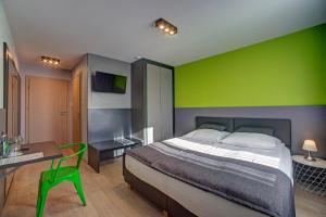 Łóżko lub łóżka w pokoju w obiekcie Wiki Sanok