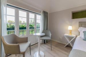 A seating area at Ver Belém Suites