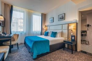 A bed or beds in a room at Eurostars Danube Budapest