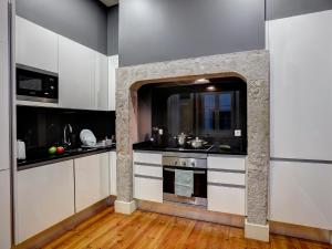 A kitchen or kitchenette at Lisbon Canaan Boutique Apartments Fanqueiros 114