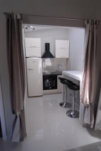 A kitchen or kitchenette at Apartments Jasmina
