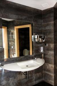 Un baño de Hotel Puerta de la Santa