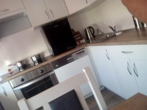 A kitchen or kitchenette at 11 Listopada 15/16