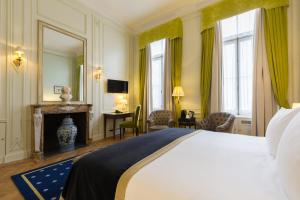 A bed or beds in a room at Stanhope Hotel by Thon Hotels