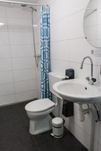 A bathroom at The Flying Pig Beach Hostel