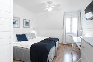 Ein Bett oder Betten in einem Zimmer der Unterkunft Hotell Stenugnen