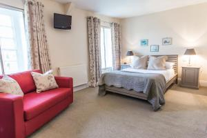 A bed or beds in a room at Bodkin House Hotel