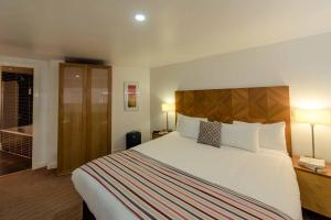 A bed or beds in a room at PREMIER SUITES Liverpool