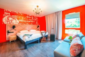 A bed or beds in a room at ibis Styles Carcassonne La Cité