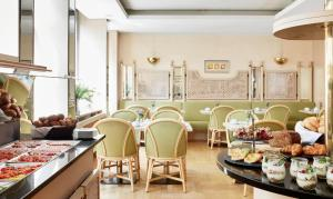 A restaurant or other place to eat at Living Hotel Kanzler