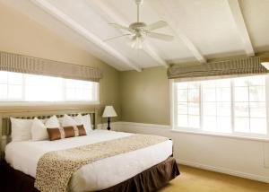 A bed or beds in a room at Homestead Resort
