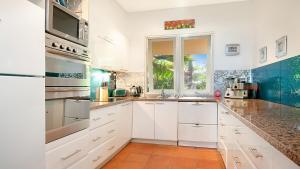A kitchen or kitchenette at Hill #8 Penthouse - Port Douglas