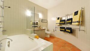 A bathroom at Hill #8 Penthouse - Port Douglas