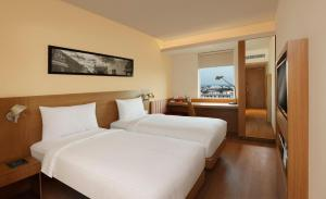 A bed or beds in a room at ibis Bengaluru Hosur Road - An AccorHotels Brand