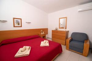 A bed or beds in a room at Verde Pino