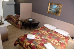 A bed or beds in a room at Civic Motor Inn