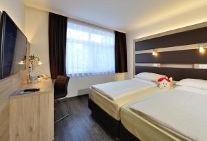 Ein Bett oder Betten in einem Zimmer der Unterkunft Michel & Friends Hotel Lüneburger Heide