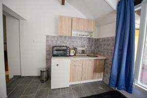 Una cocina o zona de cocina en Apartment Citta Vecchia