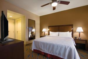 A bed or beds in a room at Homewood Suites by Hilton Oklahoma City-Bricktown