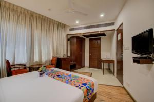 A bed or beds in a room at FabHotel Lotus Park Marathalli