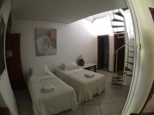 Cama ou camas em um quarto em Pousada Bizkaia
