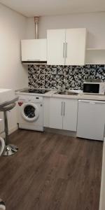 A kitchen or kitchenette at Apartamentos Sol Mayor
