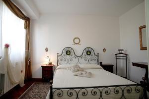 Кровать или кровати в номере Residence Criro