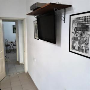 A television and/or entertainment centre at Hanna's Place - Great Location