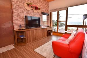A television and/or entertainment center at Rainbow Hill House