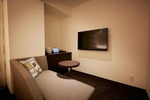 A television and/or entertainment center at Hotel Forza Nagasaki
