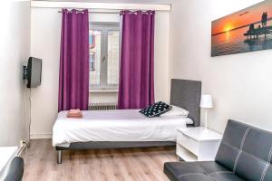 Säng eller sängar i ett rum på Hotell Linden