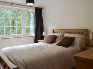 A bed or beds in a room at Snowdon