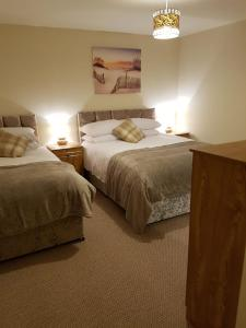 A bed or beds in a room at LegenDerry B&B