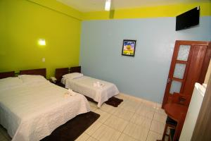 A bed or beds in a room at Amazonia Hotel