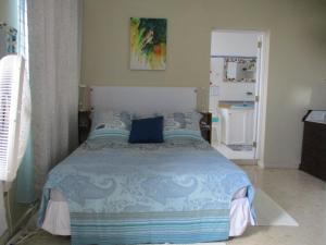 A bed or beds in a room at Chambres d´hotes La Romana
