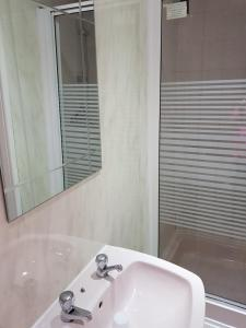 A bathroom at The Royal Windsor Hotel
