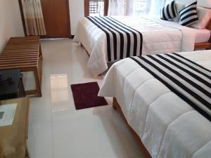 A bed or beds in a room at Marvellous Inn